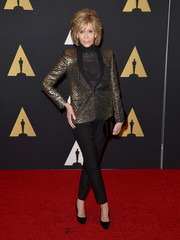 Jane Fonda was glam-drogynous in a gold leopard-patterned jacket layered over a see-through top at the Governors Awards.