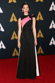 Rebecca Hall was sporty-glam in a bow-adorned, side-striped gown by Prada at the Governors Awards.