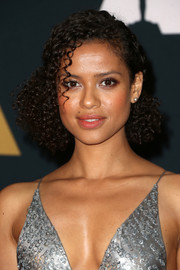 Gugu Mbatha-Raw complemented her shimmering dress with pearl studs.