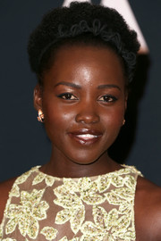 Lupita Nyong'o attended the Governors Awards sporting her natural curls.