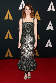 Emma Stone finished off her look with a pair of bedazzled ankle-knot sandals.