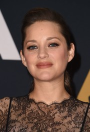 Marion Cotillard was youthful and fresh-faced at the Governors Awards wearing this ponytail.