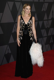Margot Robbie charmed in an embroidered and sequined velvet gown by Altuzarra at the Governors Awards.