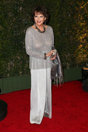 Claudia Cardinale wore gray silk pants with her beaded top for a totally sophisticated look.