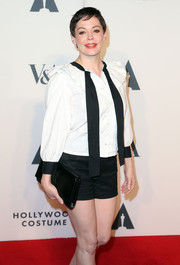 Rose McGowan complemented her casual outfit with a classy black YSL patent leather clutch when she attended the Hollywood Costume Opening Party.