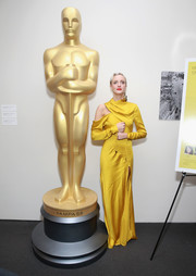 Andrea Riseborough looked red carpet-ready in a canary-yellow cutout gown by Monse at the official Academy screening of 'Battle of the Sexes.'