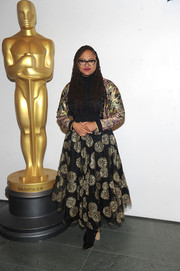 A full black maxi skirt with gold embroidery completed Ava DuVernay's eclectic outfit.