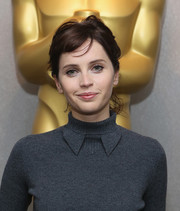 Felicity Jones looked cute even with this messy ponytail at the screening of 'The Theory of Everything.'