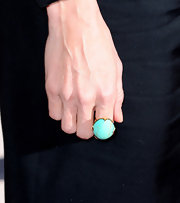 Julie Bowen spiced up her black dress with a subtle piece of jewelry. The turquoise tone really pops against the black.