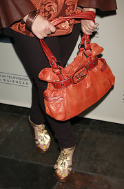 Charlene Tilton carried a glam Kathy Van Zeeland bag with studded buckles at the Emmy Reception.