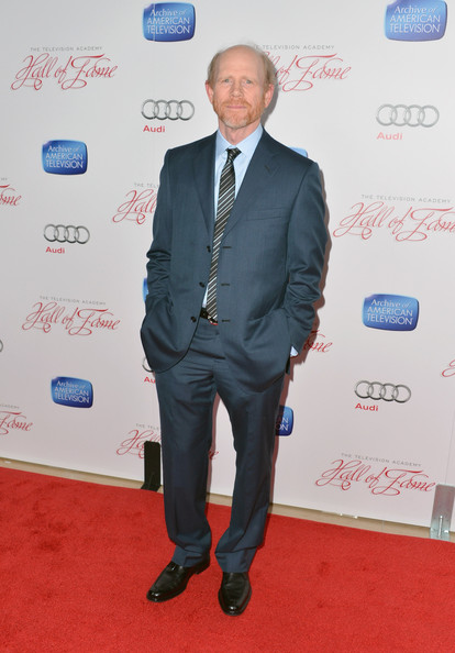 Ron Howard kept his red carpet look classic and sophisticated with this blue suit and striped tie.