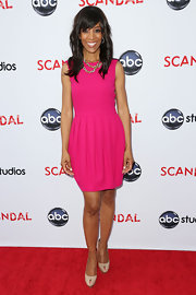 Shaun Robinson chose this hot pink sleeveless dress with a sheath skirt for her look at the 'Scandal' event in Hollywood.