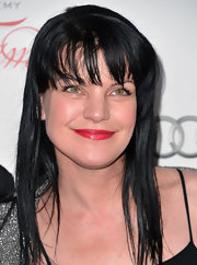 Pauley Perrette showed off her signature black locks with this long straight 'do with blunt bangs.