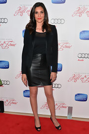 Daniela Ruah paired a black blazer with satin trim with a leather mini skirt for a sleek but edgy red carpet look.