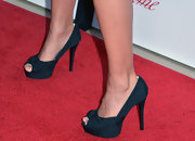Cote de Pablo kept her look fairly classic with these navy peep-toe pumps.