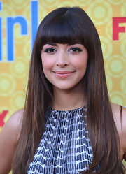 Hannah Simone arrived at a screening of 'New Girl' wearing her long shiny locks sleek and straight with blunt brow-length bangs.