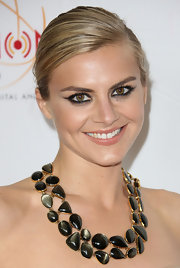 Eliza Coupe attended the College Television Awards wearing smoky retro-inspired winged eye liner with lots of lengthening mascara.