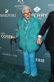 Iris Apfel matched her coat with a pair of chevron-patterned silk pants.