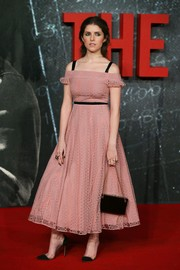 Anna Kendrick looked like a princess in a pink Burberry lace dress with a black waistband and shoulder straps during the UK premiere of 'The Accountant.'