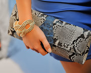 This python clutch is to die for. The blue strap accent looks awesome coupled with her blue one shoulder dress.