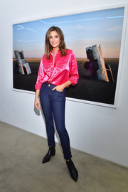 Cindy Crawford attended the Acne Studios exhibition wearing a shiny fuchsia button-down.