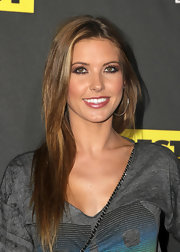 Audrina went for a casual look while attending 'The Call of Duty:Black Ops' launch party. The reality star let her highlighted brunette locks flow freely.