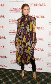 Darby Stanchfield pulled her look together with a pair of marigold platform peep-toes.