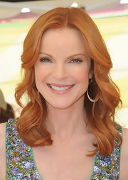 Marcia Cross paired her printed dress with shoulder length locks.