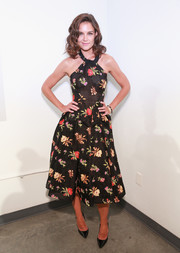 Katie Holmes looked fetching in a floral halter dress by Zac Posen during New York Fashion Week.