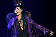 Singer Adam Lambert performs onstage during his