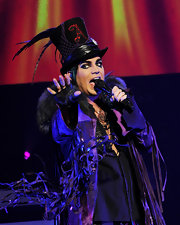 Adam Lambert loves flair... here he's performing in a feathered top hat.