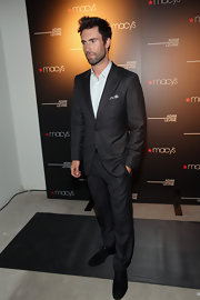 Adam Levine showed his dapper side with a dark gray suit a the launch of his fragrance collection in LA.