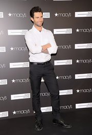 Adam Levine kept his look simple with black slacks and a white striped shirt at the launch event for his fragrances.