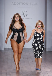 Ashley Graham proudly modeled a two-tone bodysuit from her lingerie collection during New York Fashion Week.