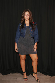Ashley Graham toughened up her dress with a cropped denim jacket.