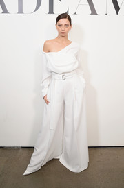 Angela Sarafyan matched her top with a pair of white wide-leg trousers.