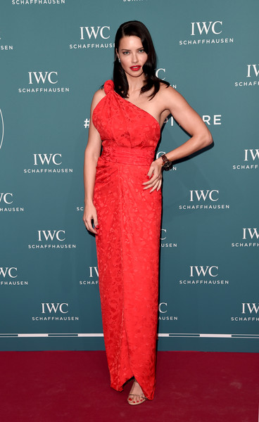 Adriana Lima One Shoulder Dress [clothing,dress,shoulder,fashion model,carpet,red carpet,red,fashion,gown,premiere,watches,iwc schaffhausen,adriana lima,red carpet,sihh 2019,geneva,switzerland,iwc schaffhausen gala,pilot,launch]