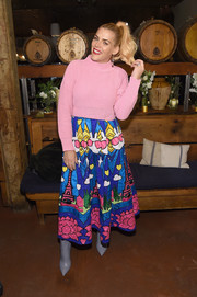 Gray ankle boots rounded out Busy Philipps' vibrant ensemble.