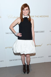 Julianne Moore contrasted her twee dress with edgy PVC ankle boots.