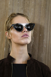 Hailey Clauson rocked a pair of cateye sunnies while waiting backstage at the Alberta Ferretti show.