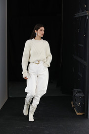 A pair of mid-calf boots completed Bella Hadid's all-white attire.