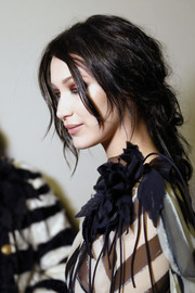 Bella Hadid rocked a messy, loose braid at the Alberta Ferretti fashion show.