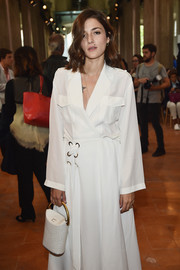 Eleonora Carisi matched a white croc-embossed purse with a loose wrap dress for the Alberta Ferretti fashion show.