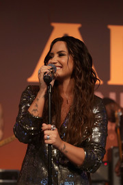 Demi Lovato sports a tattoo of the Roman numeral 'III' on her left wrist.