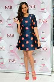 Alesha Dixon looked endearing in a star-print dress by House of Holland during the launch of her new fragrance.