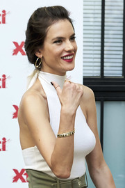 Alessandra Ambrosio attended the Xti presentation wearing a chic gold bangle by Established Jewelry.