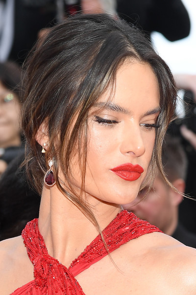 Alessandra Ambrosio Loose Bun [les miserables,hair,face,hairstyle,eyebrow,lip,beauty,chin,black hair,eyelash,cheek,alessandra ambrosio,screening,cannes,france,red carpet,the 72nd annual cannes film festival,alessandra ambrosio,2019 cannes film festival,les mis\u00e9rables,fashion,celebrity,beauty,cannes,victorias secret,model]