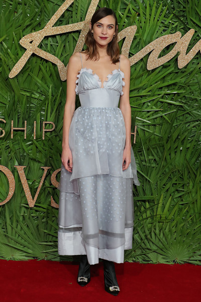 Alexa Chung Empire Gown [clothing,dress,carpet,red carpet,flooring,premiere,fashion,bridal party dress,cocktail dress,shoulder,red carpet arrivals,azzedine alaia,the fashion awards 2017,partnership with swarovski,red carpet,awards,model,british,british fashion awards,arrival]