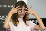 Alexa Chung showed off a dark nail color from her own manicure collection.