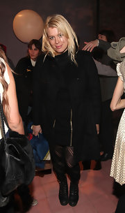 Amanda de Cadenet attended the Alexa Chung for Madewell Collection launch wearing a short dress topped with a double-breasted trench coat.